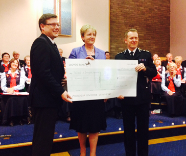 Cheque Gratefully Received from Essex Police Choir